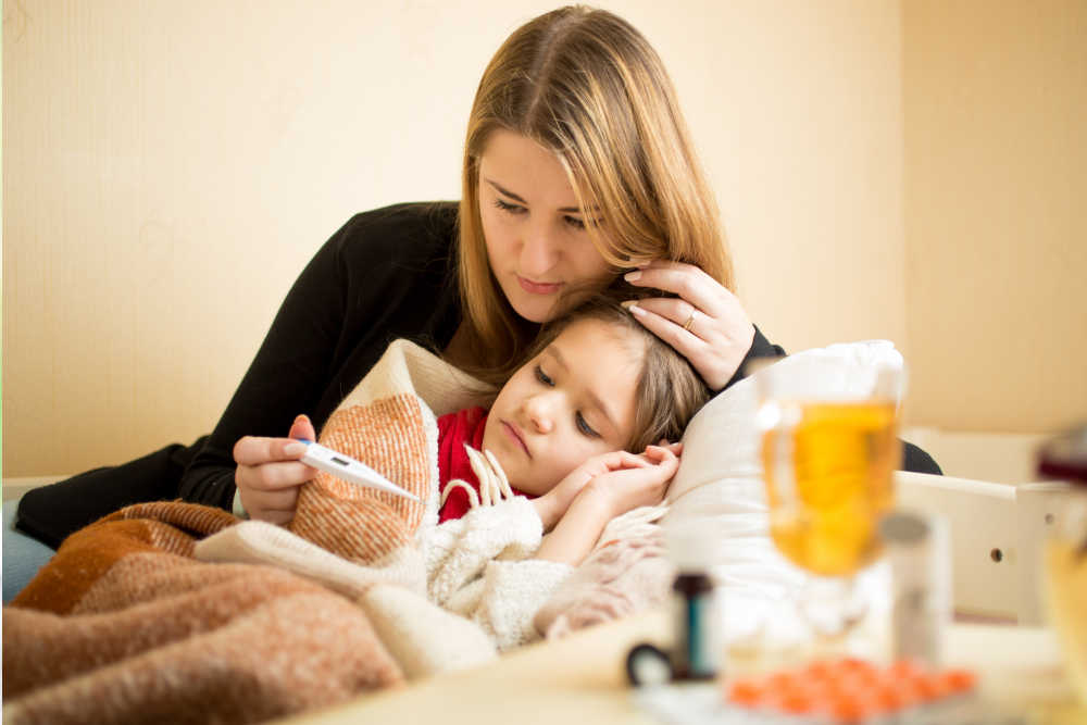 Child with sensory needs and mother monitor child's health together