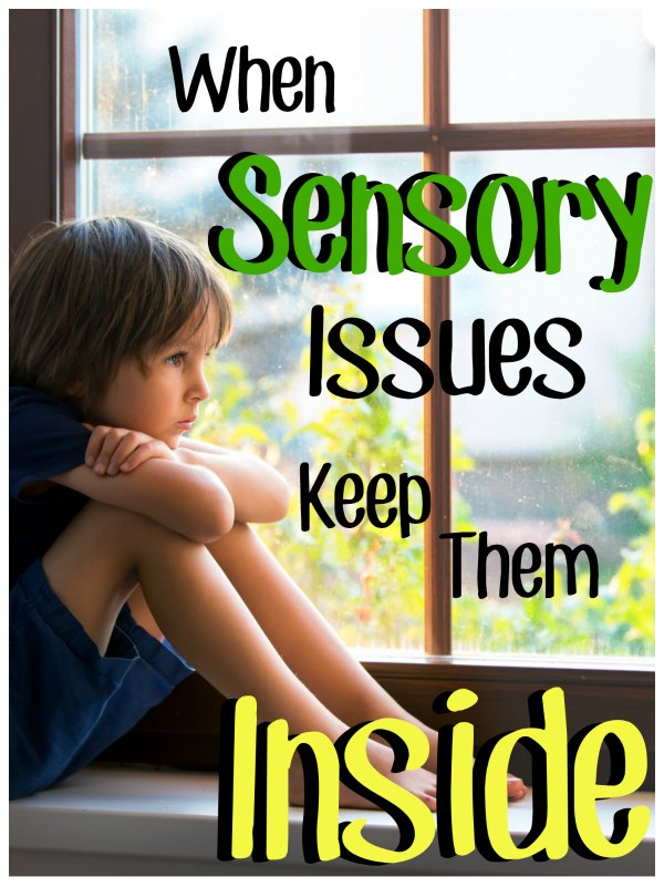 "Young boy sitting inside sadly staring out the window, with a text over lay that reads ""When Sensory Issues Keep Them Inside"""