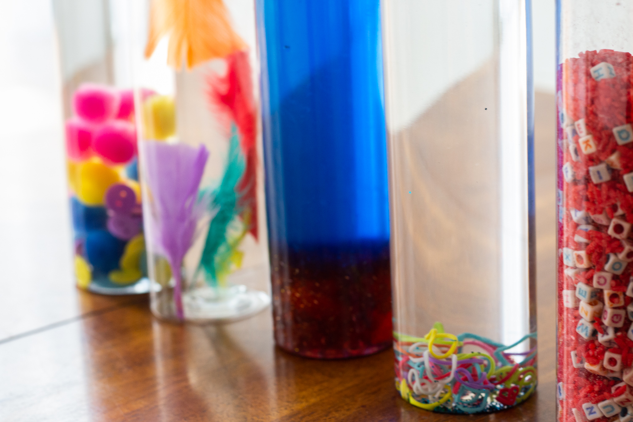 Close up shot of colorful sensory bottles